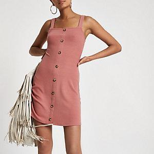 Roze geribbelde mini-jurk met knoopsluiting voor