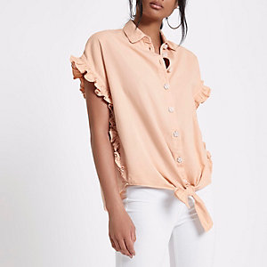 Light pink embellished tie front denim shirt