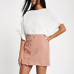 Pink corduroy button through mini skirt