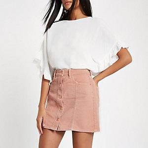 Mini jupe en velours côtelé rose boutonnée