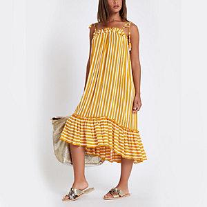 Gele gestreepte strandjurk met pompons