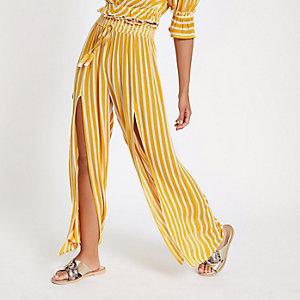 Gelbe, gestreifte Hose mit weitem Beinschnitt