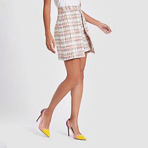 Mini-jupe en maille bouclée à carreaux rose clair