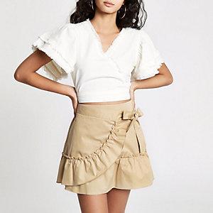 Mini-jupe portefeuille en popeline beige à volants