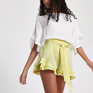 Yellow frill hem tie waist shorts