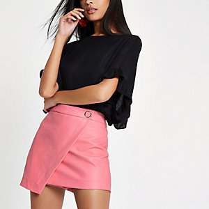 Pink faux leather wrap front skort