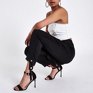 Black stirrup tapered trousers