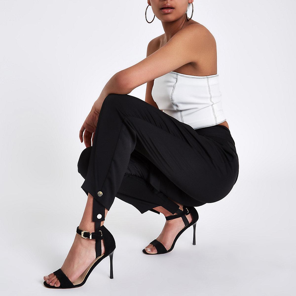 Black stirrup tapered pants