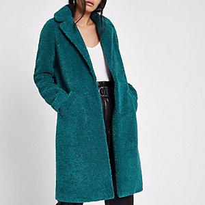 Blauwgroene jas van imitatieschapevacht