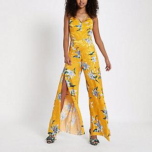 Gelber Overall mit Blumenmuster und weitem, geschlitztem Bein