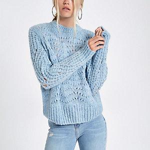 Lichtblauwe gebreide pullover