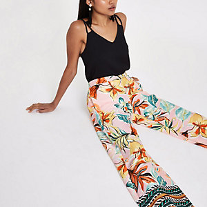 Petite pink floral print wide leg trousers