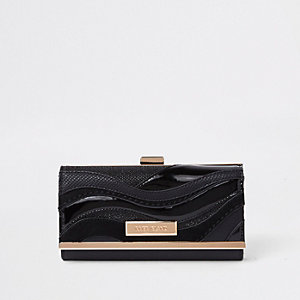 Black cutabout wave panel clip top purse