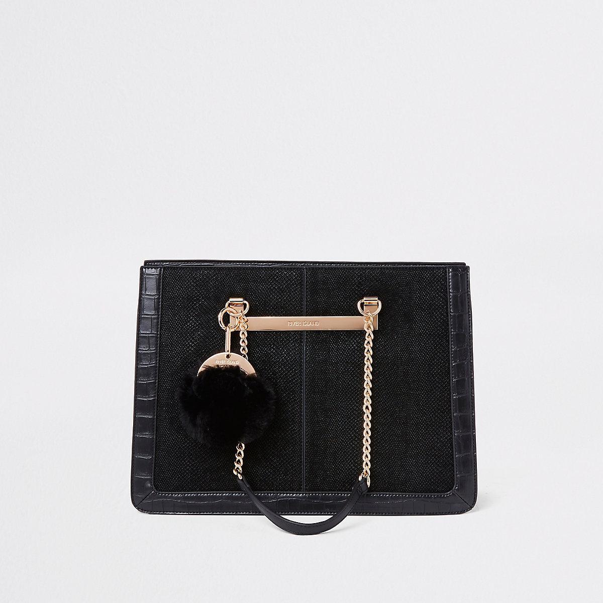 Zwarte handtas met hengselketting en pompons