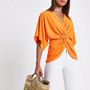 Orange twist front short sleeve top