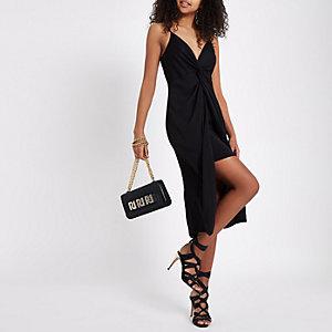Zwarte jurk met print, gedraaide voorzijde en knoop
