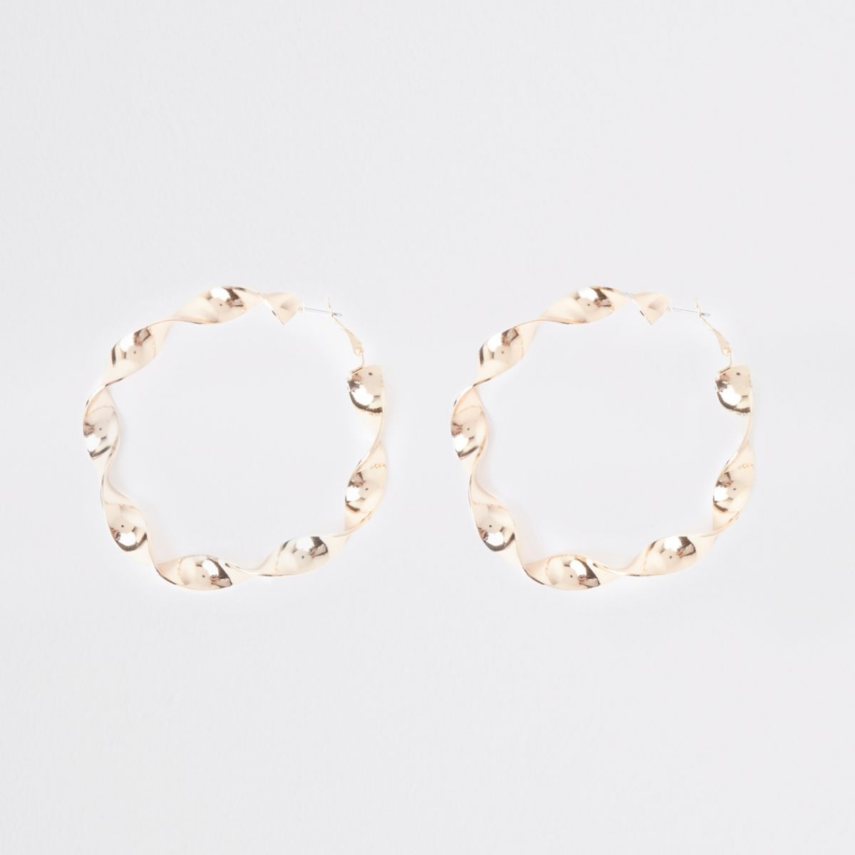 Gold tone retro twist hoop earrings