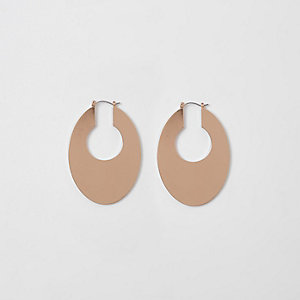 Gold tone oval hoop earrings