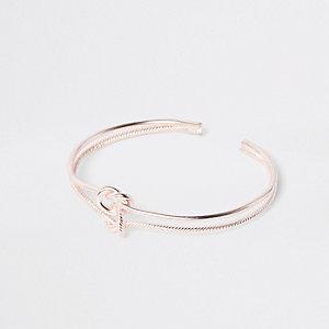 Roségoudkleurige brede armband met dubbele knoop