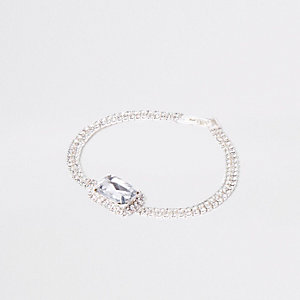 Bracelet argenté orné de strass avec pierre au centre