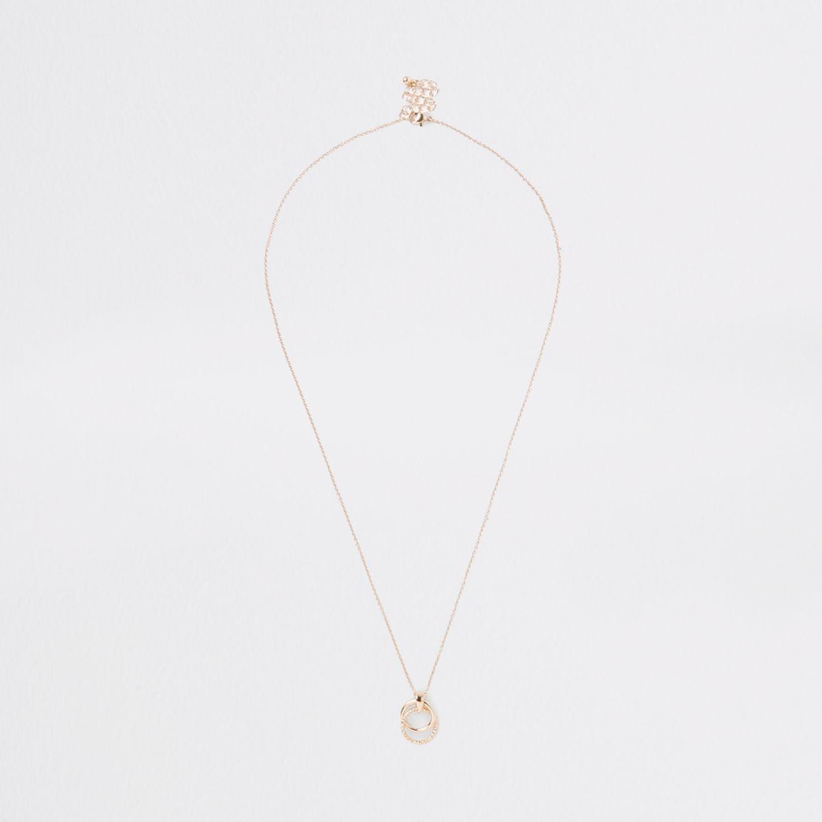 Gold tone circle pendant circle