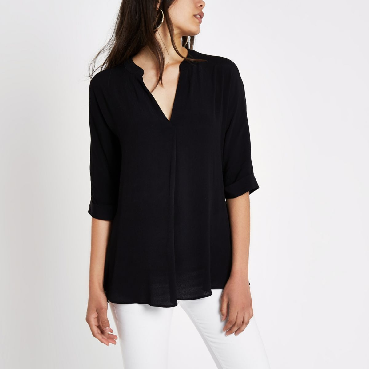 Black short sleeve twist back blouse