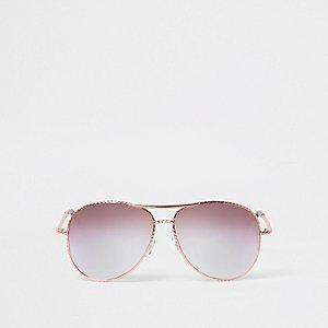 Roségouden pilotenzonnebril met gedraaid montuur en lila glazen