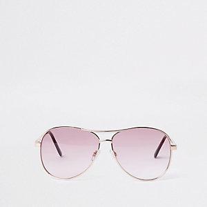 Goldene Pilotensonnenbrille mit pinken Gläsern