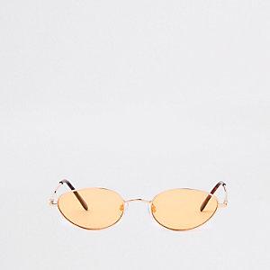 Goudkleurige zonnebril met smalle ovaalvormige gele glazen