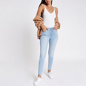 Light blue Harper super skinny rip hem jeans