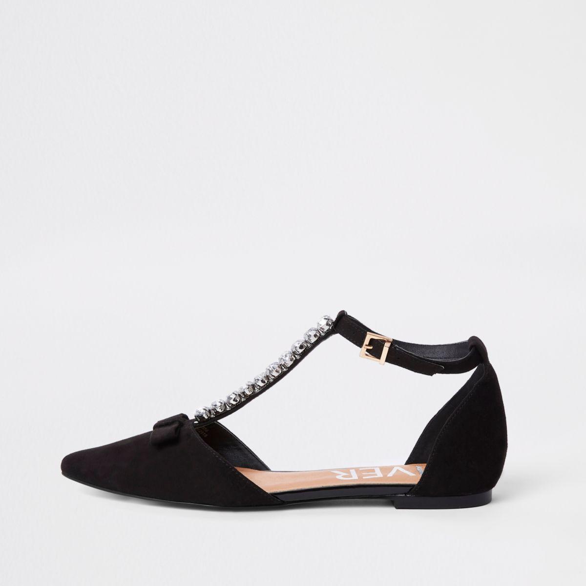 Zwarte puntige schoenen met siersteentjes en bandjes