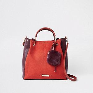Orange metal handle pouchette slouch bag