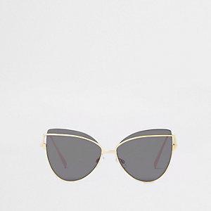 Lunettes de soleil yeux de chat dorées à verres noirs