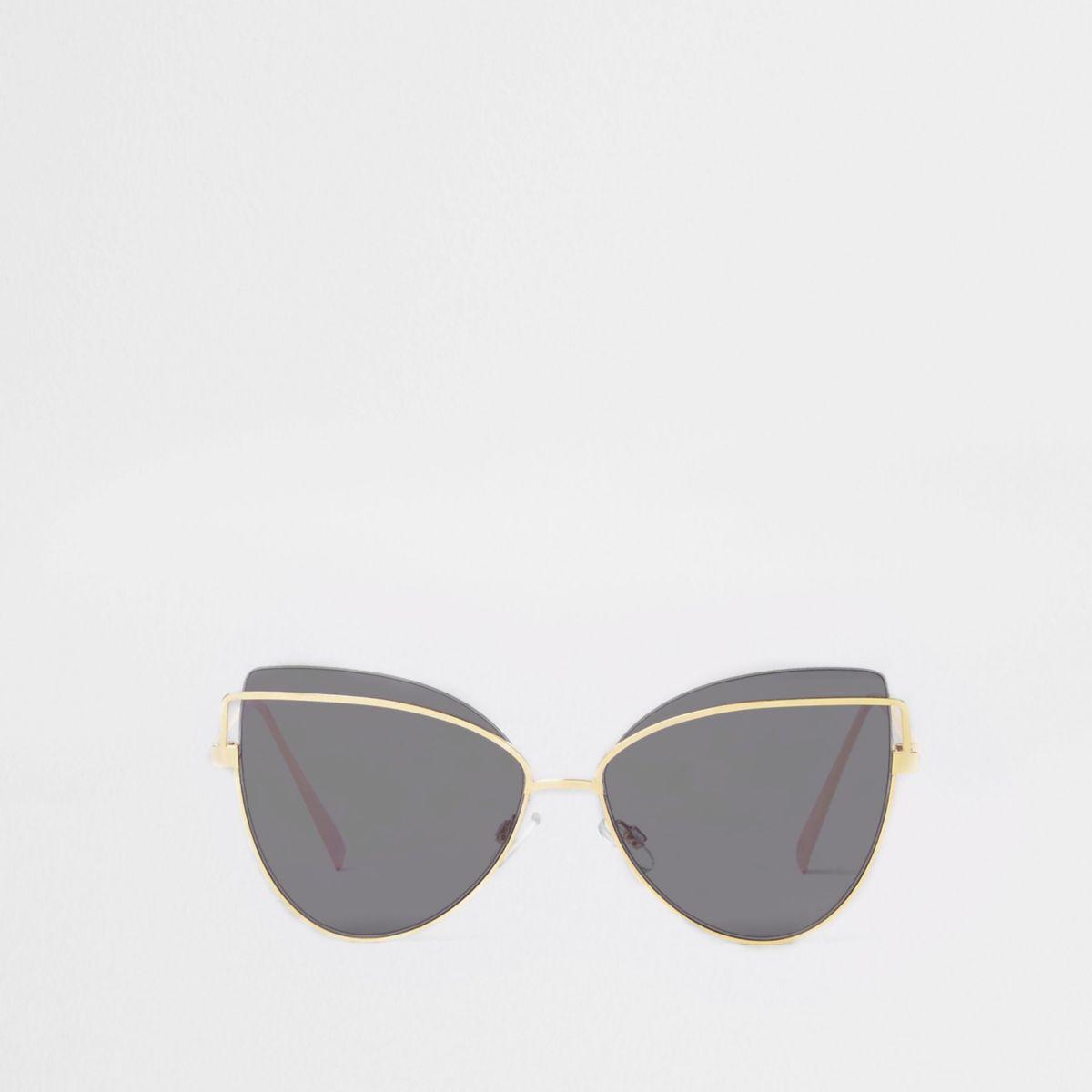 Gold tone black lens cat eye sunglasses