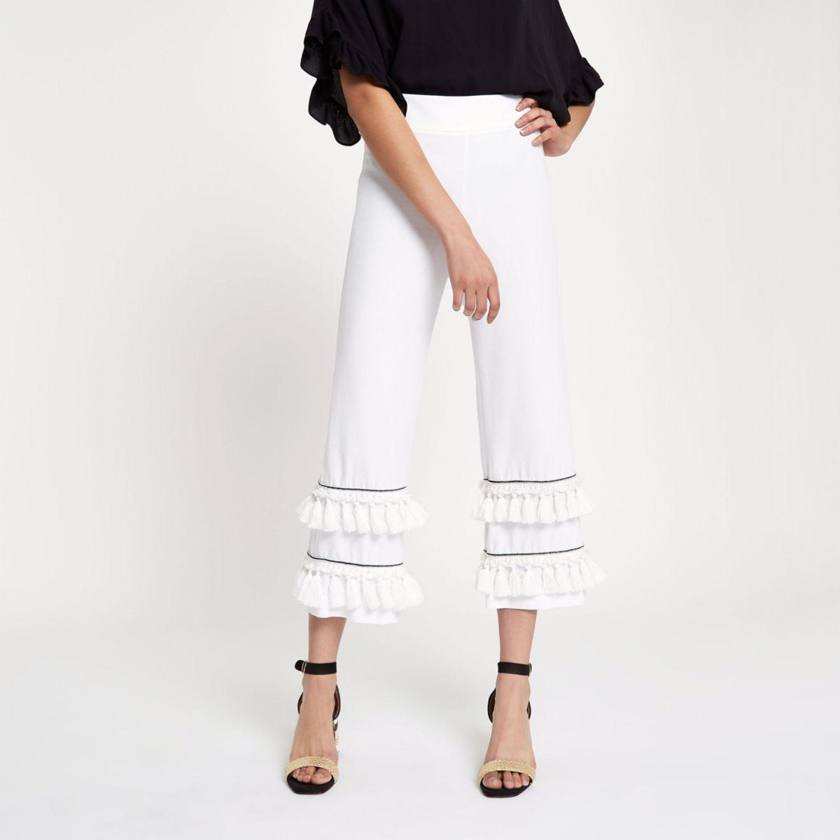 Witte cropped broek met wijde pijpen, kwastjes en franje