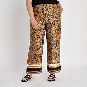 RI Plus - Oranje broek met print en wijde pijpen