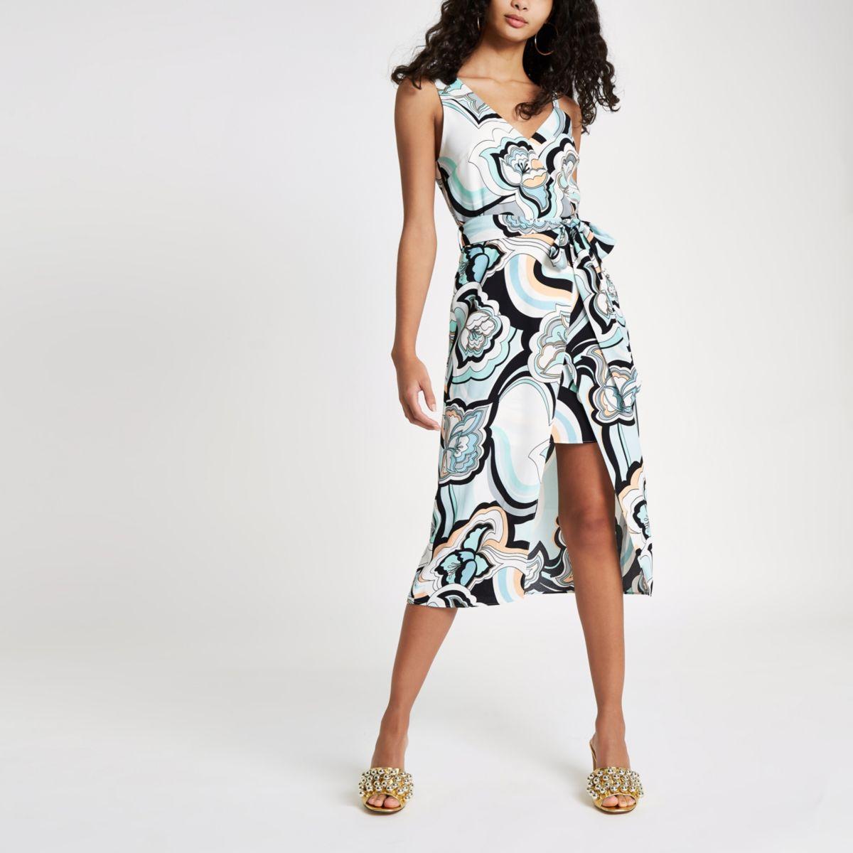 Blauwe midi-jurk met blote schouder en bloemenprint