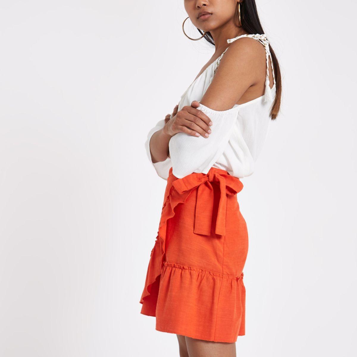 Petite orange frill wrap mini skirt