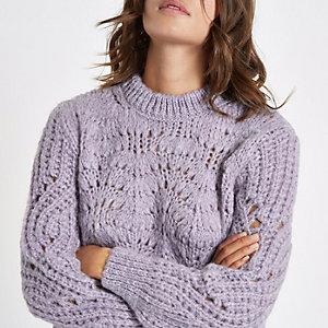 Lichtpaarse grofgebreide pullover
