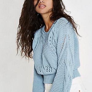 Lichtblauwe grove pullover met knoop