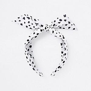 Witte hoofdband met knoop en stippen