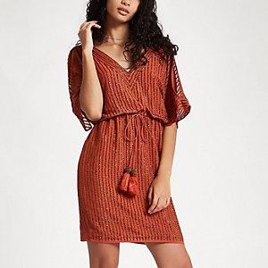 Orange versierde schouderloze mini-jurk