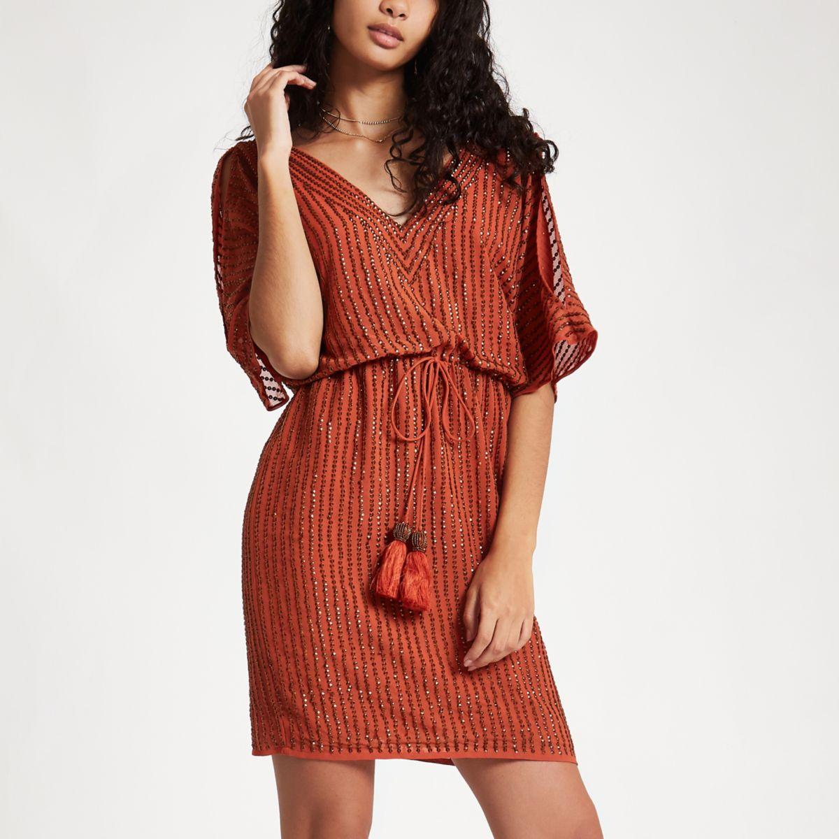 Orange embellished cold shoulder mini dress