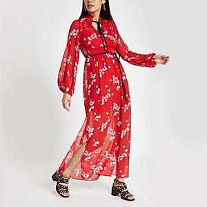 Robe longue rouge fleurie avec liens à l'encolure