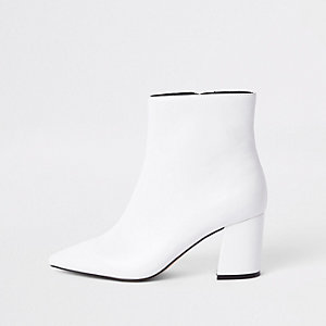 White pointed block heel boots