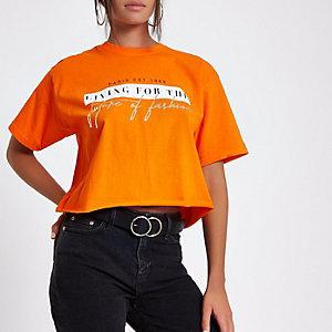 Oranje cropped T-shirt met 'future of fashion'-print
