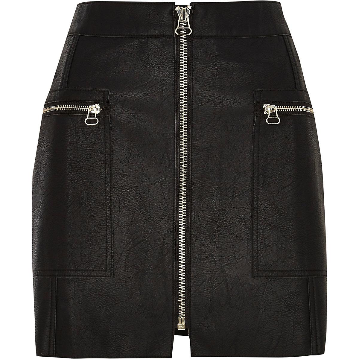 Petite black leather zip front mini skirt