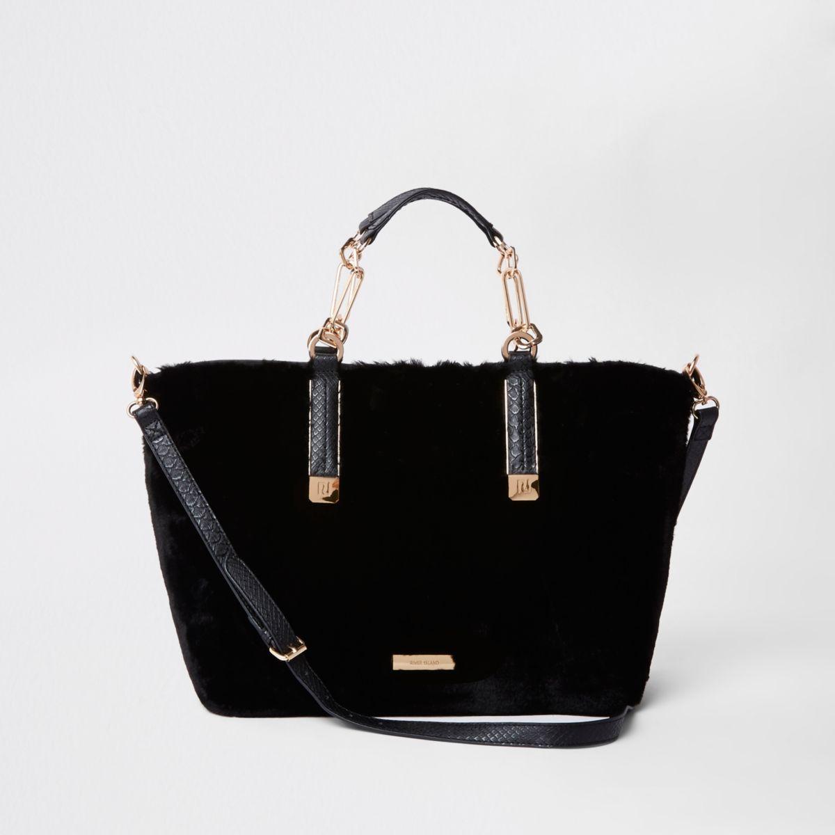 Zwarte handtas met zij-inzetten en imitatiebont