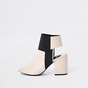 Cream block heel shoe boots