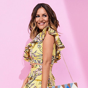 Yellow Caroline Flack one shoulder crop top